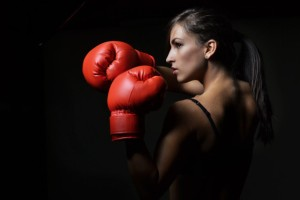 beautiful woman with the red boxing gloves, studio shot